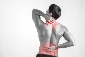 Close up of man rubbing his painful back isolated on white backg Rapid Solution Therapy